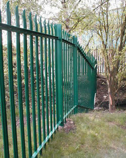 Green PVC coated palisade fencing is installed to protect premises.