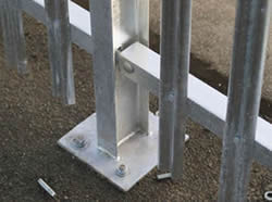 RSJ palisade fencing post with base plate are bolted to the ground