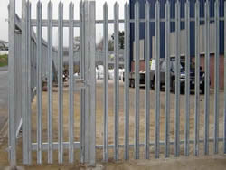 A galvanized palisade swing pedestrian gate with single leaf