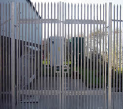 A galvanized palisade swing pedestrian gate with double leaves